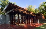 Frank Lloyd Wright's Usonian-style house features expansive glass walls for nature views